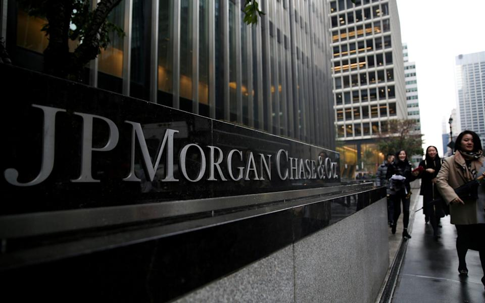 A sign of JP Morgan Chase Bank is seen in front of their headquarters tower in New York - Amr Alfiky/REUTERS