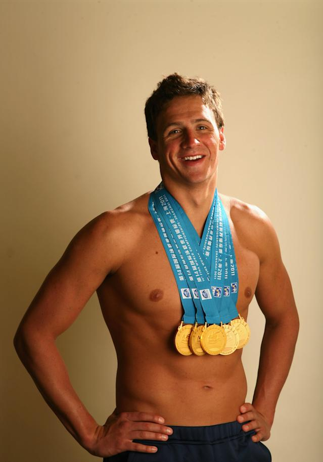 PALO ALTO, CA - AUGUST 03: Swimmer Ryan Lochte poses with the gold medals he recently won at the 2011 FINA World Championships during a photo shoot on August 3, 2011 at the Crown Plaza Cabana Hotel in Palo Alto, California. Lochte won a total of six medals at the championships, five golds and one bronze. (Photo by Ezra Shaw/Getty Images)