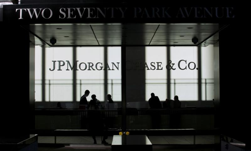 People walk inside JP Morgan headquarters in New York, in this file photo from October 25, 2013. Names, addresses, phone numbers and email addresses of roughly 76 million households and seven million small businesses were exposed when computer systems at JPMorgan Chase & Co were hacked in a recent cyber attack, the company said in a statement October 2, 2014.   REUTERS/Eduardo Munoz/Files  (UNITED STATES - Tags: BUSINESS SCIENCE TECHNOLOGY LOGO)