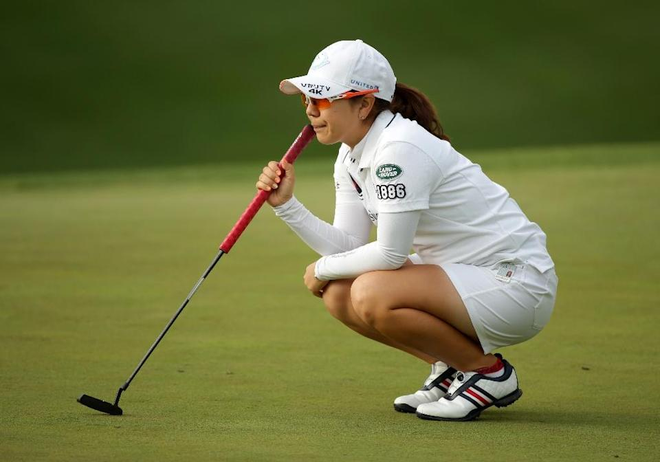 Mika Miyazato of Japan lines up her par putt on the ninth hole during the first round of the Kingsmill Championship on May 19, 2016 in Williamsburg, Virginia (AFP Photo/Hunter Martin)