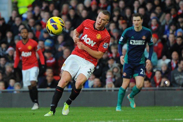 Manchester United's midfielder Tom Cleverley (C) scores in Manchester on December 15, 2012
