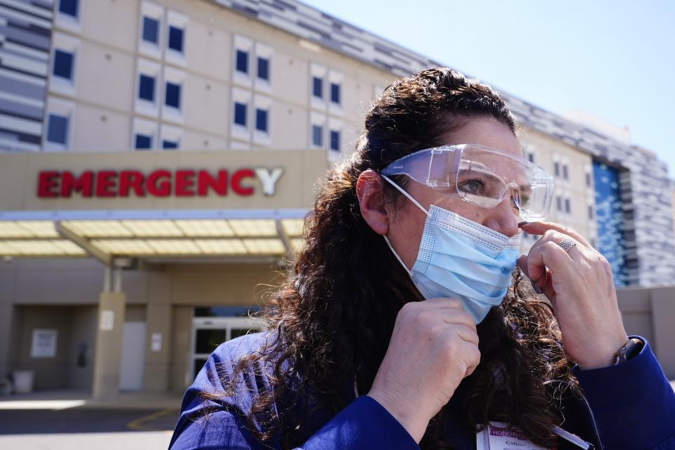 Caroline Maloney, a 55-year-old ICU nurse at Scottsdale Osborne Medical Center, has been treating COVID-19 patients throughout the entire pandemic, is shown Thursday, Aug. 26, 2021, in Scottsdale, Ariz. Arizona surpassed the grim milestone of 1 million confirmed coronavirus cases on Friday, Aug. 27, after the state reported new infections amid continued wrangling over vaccinations and mask requirements. (AP Photo/Ross D. Franklin)