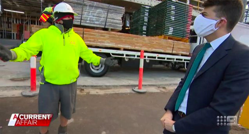 Tradesman Peter Nentis stands with a reporter on a worksite in Melbourne's inner-city.