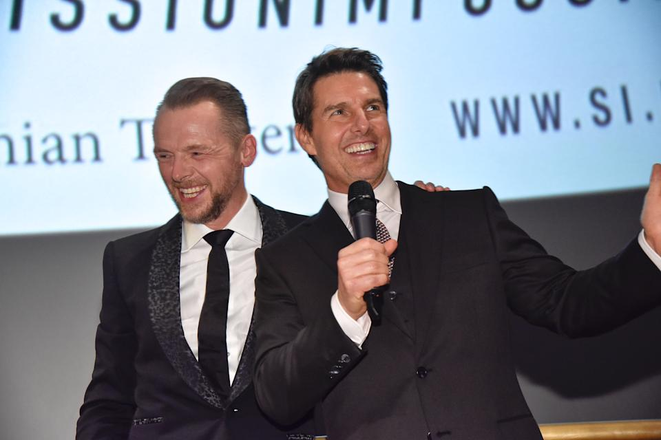 Actors Simon Pegg and Tom Cruise attend the