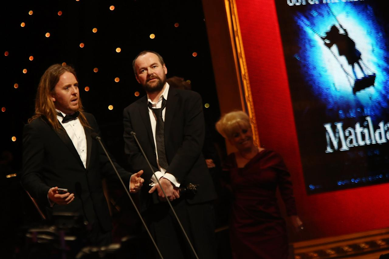 """LONDON, ENGLAND - APRIL 15:  (EXCLUSIVE COVERAGE)  Tim Minchin  and Matthew Warchus accept the award for Best Musical for """"Matilda The Musical"""" at the 2012 Olivier Awards at The Royal Opera House on April 15, 2012 in London, England.  (Photo by Tim Whitby/Getty Images)"""