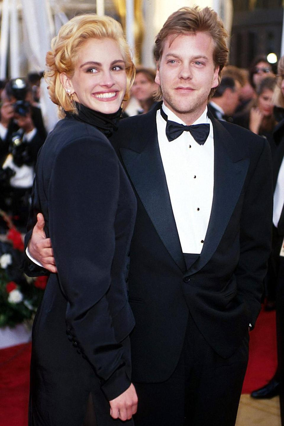 <p>Julia Roberts ditched her long, auburn locks for a short blonde look and arrived with her date, Kiefer Sutherland. She was nominated for <em>Pretty Woman </em>that year. </p>