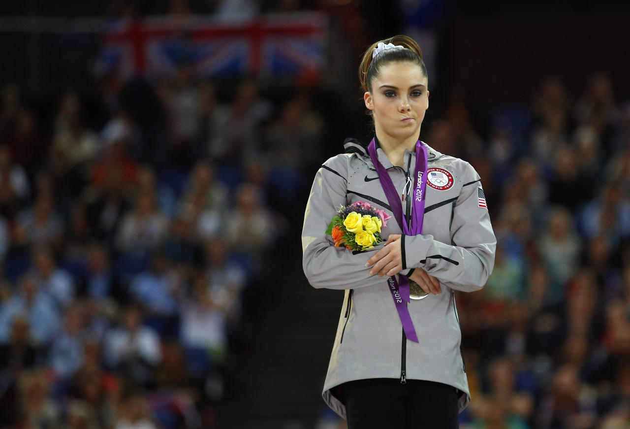 McKayla Maroney of the U.S. celebrates with her silver medal in the women's vault victory ceremony in the North Greenwich Arena during the London 2012 Olympic Games August 5, 2012.   REUTERS/Brian Snyder (BRITAIN  - Tags: OLYMPICS SPORT GYMNASTICS TPX IMAGES OF THE DAY)