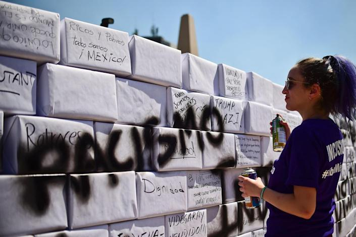 'Racismo': Demonstrators carried signs calling for unity and an end to racism (AFP/Getty Images)