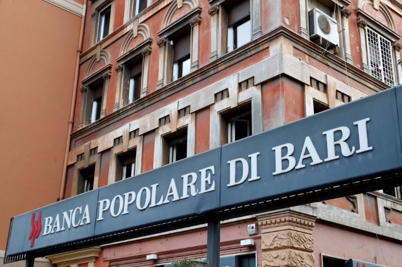 FILE PHOTO: The logo of Banca Popolare di Bari bank is pictured outside the company's branch in Rome