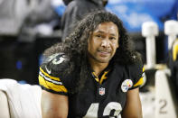 FILE - In this Saturday, Jan. 3, 2015 file photo, Pittsburgh Steelers strong safety Troy Polamalu (43) sits on the bench during the second half of a 30-17 loss to the Baltimore Ravens in an NFL wildcard playoff football game in Pittsburgh. Former Pittsburgh Steelers star Troy Polamalu has carved his own unique path to the Hall of Fame. Polamalu spent 12 seasons in Pittsburgh, winning a pair of Super Bowls while being named to the Pro Bowl eight times. (AP Photo/Gene J. Puskar, File)