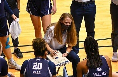 Monmouth women's basketball coach Jody Craig diagrams play in a game against Rider last month. Craig resigned on March 10.