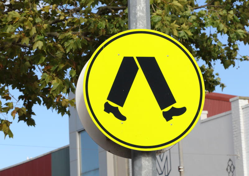 Pedestrian crossing sign showing where mobility scooters and walkers should cross.