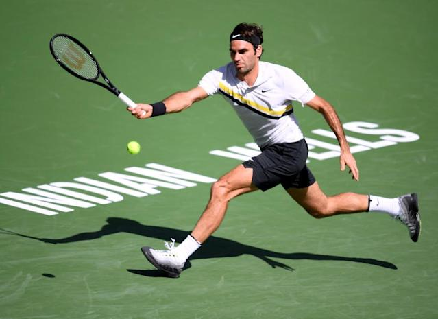 Roger Federer continued to defy the ageing process as he needed just 58 minutes to overpower Filip Krajinovic 6-2, 6-1 at Indian Wells (AFP Photo/Harry How)