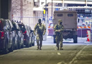National Guard troops patrol under the Hennepin County Courthouse in Minneapolis, Minn., Monday, March 8, 2021, the site of the trial of former Minneapolis police officer Derek Chauvin in the death of George Floyd. (Glen Stubbe/Star Tribune via AP)