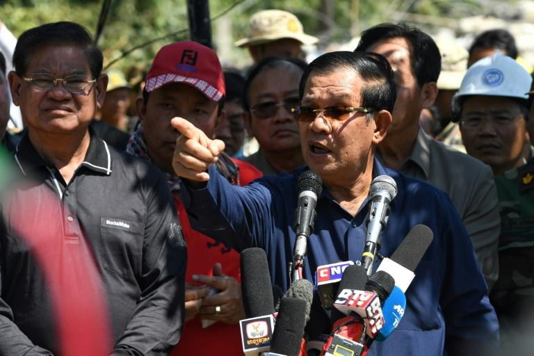 Cambodia's Prime Minister Hun Sen (R) speaks during a press conference at the site of the collapse (AFP Photo/TANG CHHIN Sothy)