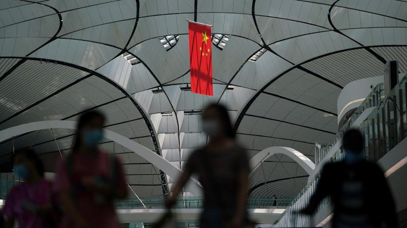 China unveils tighter coronavirus testing rules for travellers from the US