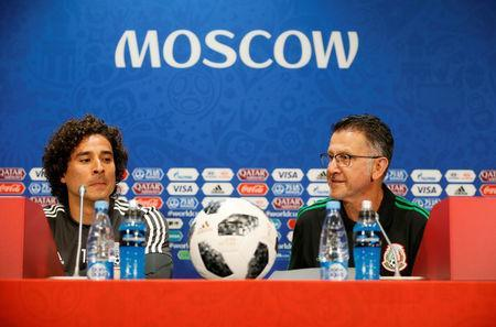 Soccer Football - World Cup - Mexico Press Conference - Luzhniki Stadium, Moscow, Russia - June 16, 2018 Mexico coach Juan Carlos Osorio with Guillermo Ochoa during the press conference REUTERS/Gleb Garanich