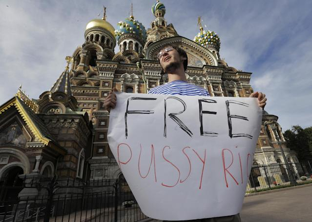 A demonstrator stands in a picket in support of the Russian punk group Pussy Riot whose members face prison for a stunt against President Vladimir Putin, in front of the Savior of Spilled Blood Cathedral in St.Petersburg, Russia, Friday, Aug. 17, 2012. A Moscow judge has sentenced each of three members of the provocative punk band Pussy Riot to two years in prison on hooliganism charges following a trial that has drawn international outrage as an emblem of Russia's intolerance to dissent. ( AP Photo/Dmitry Lovetsky)