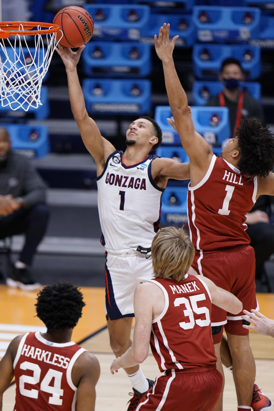 Gonzaga guard Jalen Suggs, left, shoots in front of Oklahoma forward Jalen Hill in the second half of a college basketball game in the second round of the NCAA tournament at Hinkle Fieldhouse in Indianapolis, Monday, March 22, 2021. (AP Photo/AJ Mast)