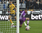 Wolverhampton Wanderers' Hwang Hee-chan, left, scores past Newcastle's goalkeeper Karl Darlow his side's opening goal during the English Premier League soccer match between Wolverhampton Wanderers and Newcastle United at Molineux stadium in Wolverhampton, England, Saturday, Oct. 2, 2021. (AP Photo/Rui Vieira)