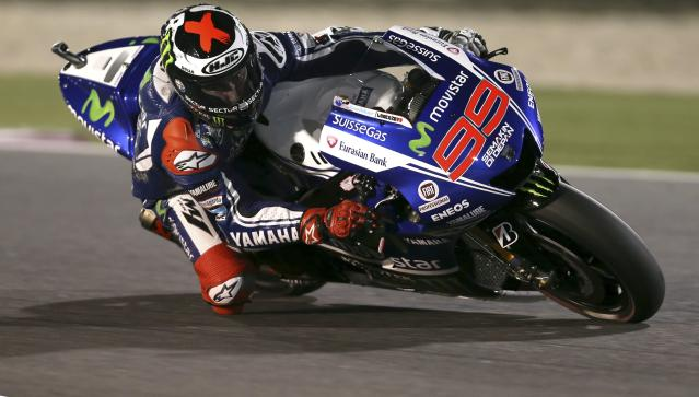 Yamaha MotoGP rider Jorge Lorenzo of Spain races during a free practice session at the MotoGP World Championship at the Losail International circuit in Doha March 21, 2014. REUTERS/Fadi Al-Assaad (QATAR - Tags: SPORT MOTORSPORT)