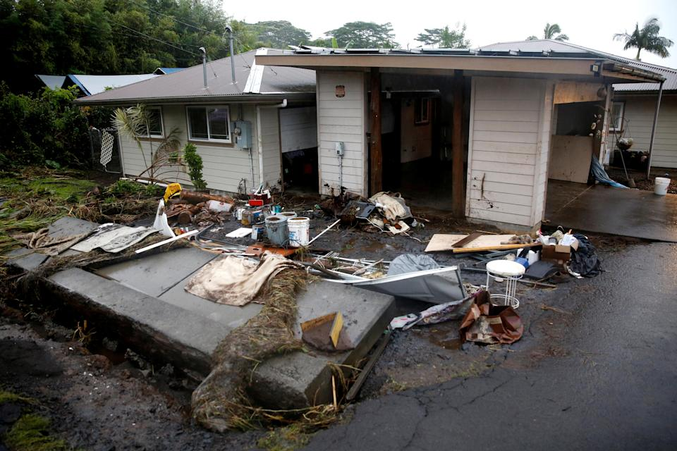 <p>A retaining wall lies on its side after being toppled by flooding caused by Hurricane Lane in Hilo, Hawaii, Aug. 25, 2018. (Photo: Terray Sylvester/Reuters) </p>
