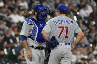 Chicago Cubs catcher Austin Romine, left, talks with starting pitcher Keegan Thompson during the first inning of the team's baseball game against the Chicago White Sox in Chicago, Friday, Aug. 27, 2021. (AP Photo/Nam Y. Huh)
