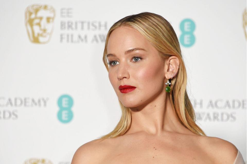 <p>JLaw has made us all want to rush to Claire's Accessories with this display. Her modern piercings have a glamorous Hollywood makeover, surrounding the gorgeous vintage emerald drop earring. </p>