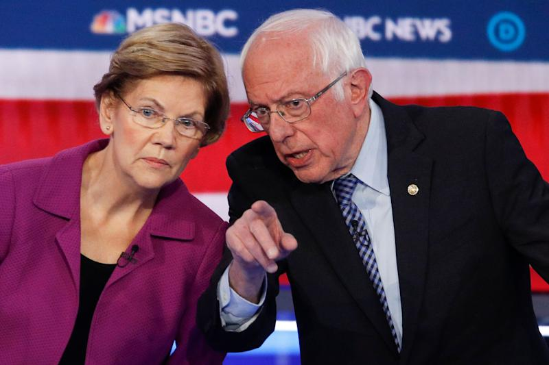 Sen. Elizabeth Warren and Sen. Bernie Sanders talk during a Democratic presidential primary debate on Feb. 19, 2020. (Photo: ASSOCIATED PRESS)