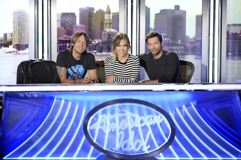 "This 2013 publicity photo released by FOX shows judges, from left, Keith Urban, Jennifer Lopez and Harry Connick Jr. for FOX's ""American Idol XIII."" Pop star and actress Lopez will be back on ""American Idol"" after a two-season run as judge in 2011 and 2012 that was a boon for the show and her career. Connick, a respected jazz singer and musician, proved adept as a mentor in several ""Idol"" appearances. (AP Photo/Copyright FOX, Michael Becker)"