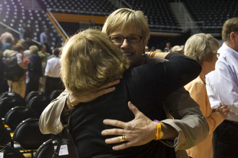 "New Tennessee women's basketball head coach Holly Warlick is congratulated after a news conference Thursday, April 19, 2012, in Knoxville, Tenn. Pat Summitt, the sport's winningest coach, stepped aside as head coach of the Lady Vols on Thursday, taking the title of ""head coach emeritus"" The 59-year-old coach revealed Aug. 23 that she had been diagnosed with early onset dementia, Alzheimer's type. (AP Photo/The Knoxville News Sentinel, Saul Young)"