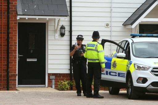 A police officer stands guard outside Charlie Rowley's house in Amesbury, southern England, on July 4, 2018 after a Novichok poisoning days earlier