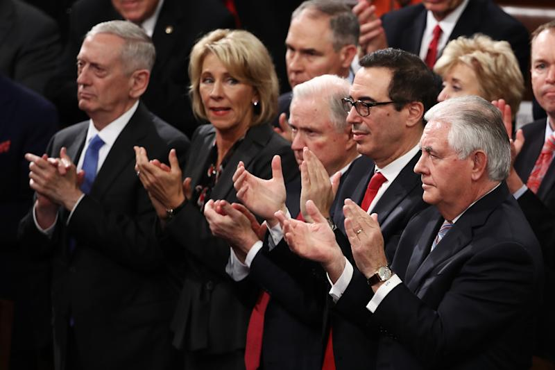 WASHINGTON, DC - FEBRUARY 28: Members of President Trump's cabinet Secretary of Defense Gen. James Mattis (L), Education Secretary Betsy DeVos (2nd L), Treasury Secretary Steve Mnuchin (2nd R), and Secretary of State Rex Tillerson (R) attend Trump's address a joint session of the U.S. Congress on February 28, 2017 in the House chamber of the U.S. Capitol in Washington, DC. Trump's first address to Congress focused on national security, tax and regulatory reform, the economy, and healthcare. (Photo by Win McNamee/Getty Images)