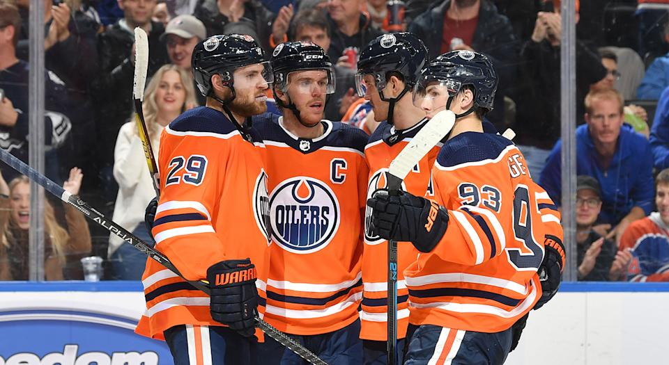 EDMONTON, AB - NOVEMBER 14:  Leon Draisaitl #29, Connor McDavid #97, Oscar Klefbom #77 and Ryan Nugent-Hopkins #93 of the Edmonton Oilers celebrate after a goal during the game against the Colorado Avalanche on November 14, 2019, at Rogers Place in Edmonton, Alberta, Canada. (Photo by Andy Devlin/NHLI via Getty Images)