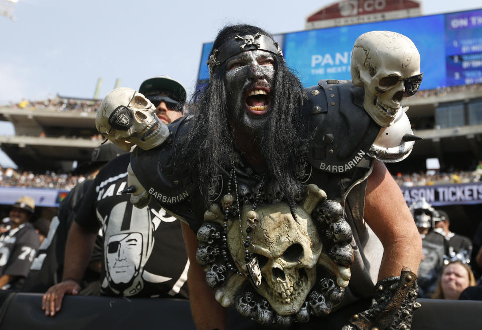 "Raiders fans in the ""Black Hole"" always added to the festivities in Oakland. (AP Photo/Tony Avelar, File)"