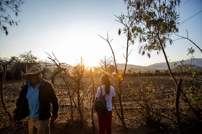 Francisco Sical and Melissa Sical get ready to walk her to  school as the sun rises over their village in Baja Verapaz, Guatemala, in early March 2020.