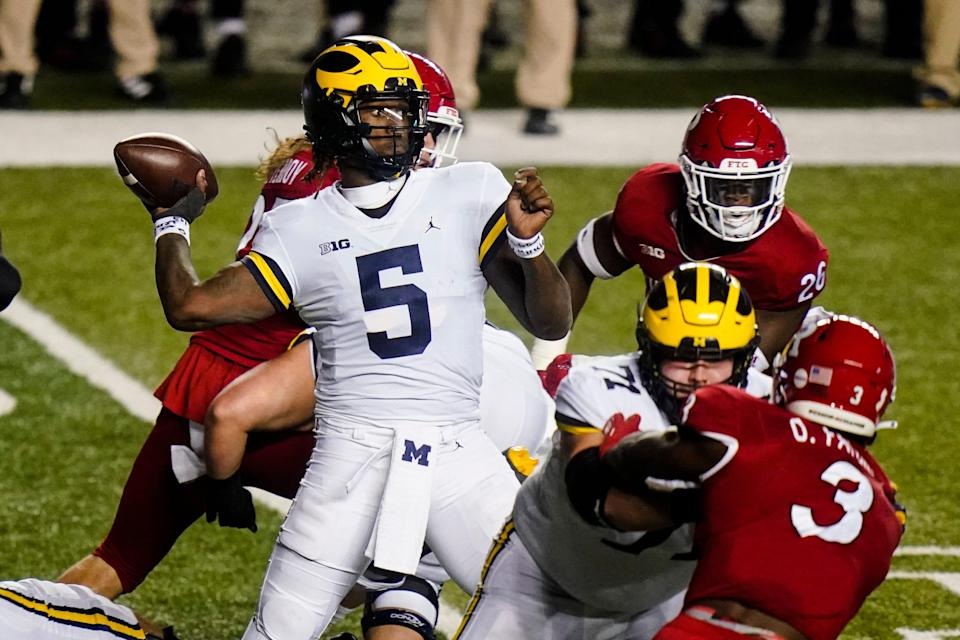 Michigan quarterback Joe Milton (5) throws a pass during the first half of the team's NCAA college football game against Rutgers on Saturday, Nov. 21, 2020, in Piscataway, N.J.
