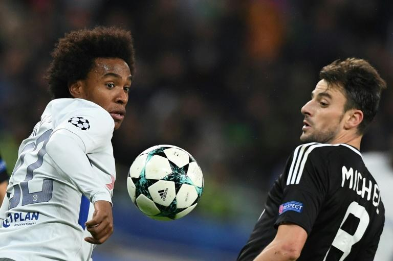 Chelsea's midfielder Willian (L) and Qarabag's midfielder Michel vie for the ball during the UEFA Champions League Group C football match November 22, 2017