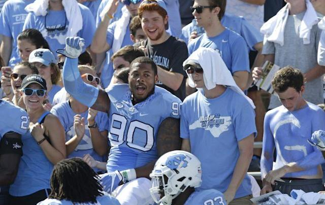 North Carolina's Nazair Jones (90) rubs elbows with the student body at a game this season. (AP)