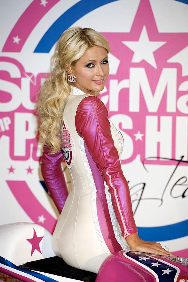 """Gallivanting around the world on her holiday break, Paris Hilton stopped off in Madrid, Spain, to announce that she'll have her very own team competing in the 2011 125cc MotoGP World Championship next season. Her team's name? SuperMartxe VIP by Paris Hilton. """"I can't believe I have my own racing team! So cool! :)"""" the heiress tweeted at the launch. Juan Naharro Gimenez/<a href=""""http://www.wireimage.com"""" target=""""new"""">WireImage.com</a> - December 18, 2010"""