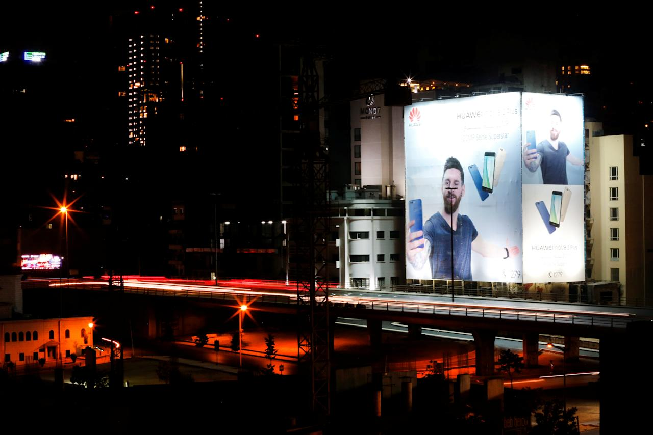 An advertisement for Huawei mobile phones with Argentinian and FC Barcelona soccer player Lionel Messi seen in Beirut August 7, 2017. Picture taken August 7, 2017. REUTERS/ Mohamed Azakir
