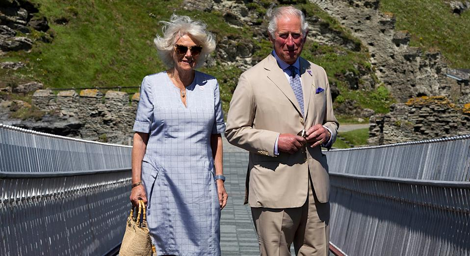 The Duke and Duchess of Cornwall attend a ribbon cutting ceremony at the new Tintagel bridge in Cornwall, England, on 20 July.  (Getty Images)