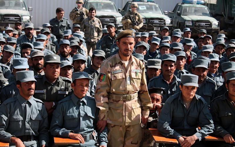 Afghan General Abdul Raziq  poses for a picture during a graduation ceremony at a police training centre in Kandahar province - AFP