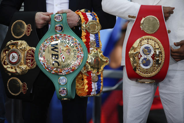 (L-R) Canelo Alvarez won Danny Jacobs' IBF belt earlier this year to unify the middleweight division. Now he's at risk of being stripped of that title. (AP)