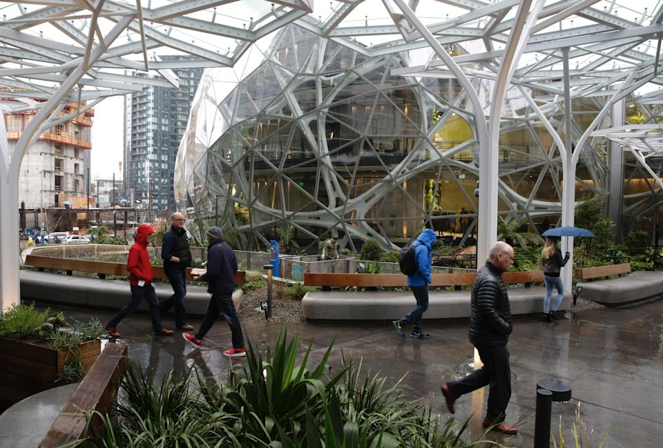 People take a tour during the grand opening of the Amazon Spheres, in Seattle, Washington on January 29, 2018. Amazon opened its new Seattle office space which looks more like a rainforest. The company created the Spheres Complex to help spark employee creativity.  / AFP PHOTO / JASON REDMOND        (Photo credit should read JASON REDMOND/AFP via Getty Images)