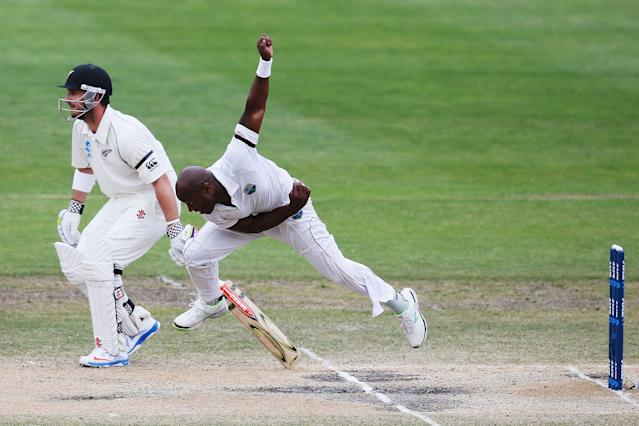 DUNEDIN, NEW ZEALAND - DECEMBER 07: Tino Best of thre West Indies bowls during day five of the first test match between New Zealand and the West Indies at University Oval on December 7, 2013 in Dunedin, New Zealand. (Photo by Hannah Johnston/Getty Images)