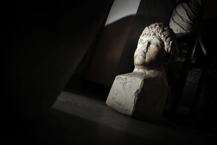 This Friday, Oct. 5, 2012 photo shows ancient Roman sculpture, found on the site of Ratiaria, an ancient Roman settlement located on the banks of the Danube, in the northwest corner of Bulgaria. Located on the crossroads of many ancient civilizations, Bulgarian scholars rank their country behind only Italy and Greece in Europe for the numbers of antiquities lying in its soil. But Bulgaria has been powerless to prevent the rape of its ancient sites, depriving the world of part of its cultural legacy and also costing this impoverished Balkan nation much-needed tourism revenue. (AP Photo/Valentina Petrova)