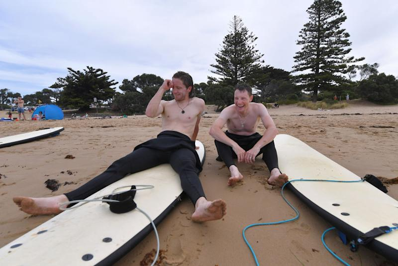 Deceuninck-QuickStep teammates Shane Archbold and Sam Bennett share a joke while trying out a bit of surfing on some downtime ahead of the 2020 Cadel Evans Great Ocean Road Race