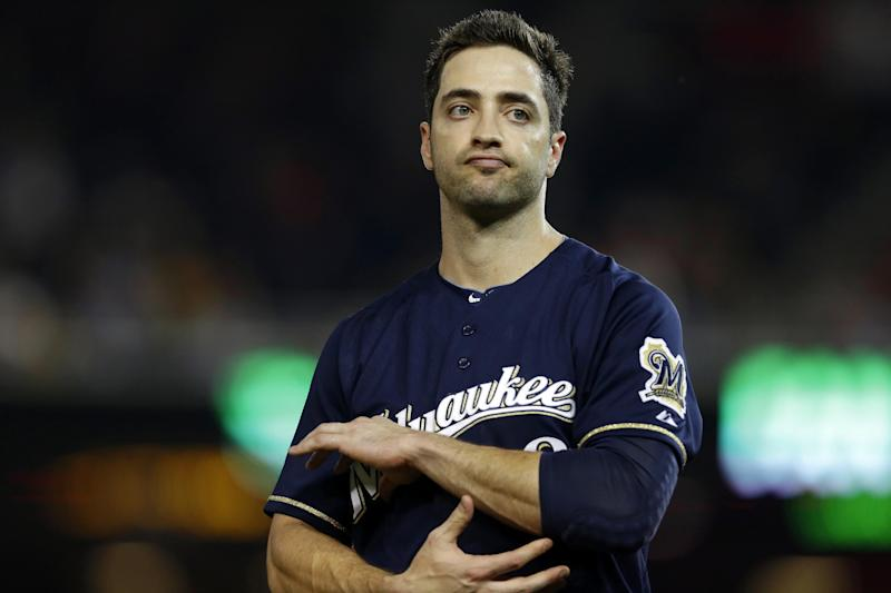 """FILE - In this Sept. 21, 2012 file photo, Milwaukee Brewers Ryan Braun holds his elbow after missing a swing during a baseball game against the Washington Nationals at Nationals Park, in Washington. Braun, a former National League MVP, on Monday, July 22, 2013 was suspended without pay for the rest of the season and admitted he """"made mistakes"""" in violating Major League Baseball's drug policies. (AP Photo/Jacquelyn Martin, File)"""