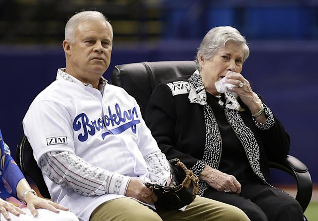 Don Zimmer's wife Soot, right, and son Tom watch a video tribe to Rays senior baseball advisor Don Zimmer before a baseball game Saturday, June 7, 2014, in St. Petersburg, Fla. Don Zimmer passed way earlier this week at the age of 83. (AP Photo/Chris O'Meara)